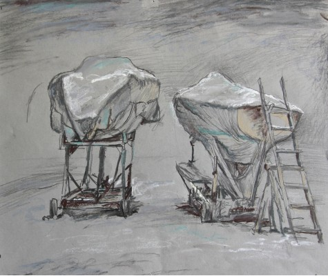 Sailboats high and dry on shore